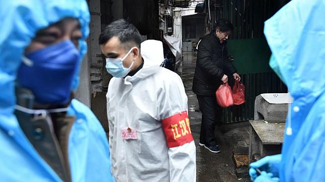 الصين تعلن 22 وفاة جديدة بفيروس كورونا ليصل إجمالي الضحايا إلى 3158 شخصا